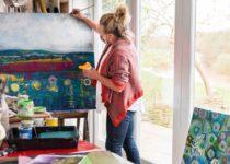Lesley Seeger painting in her studio